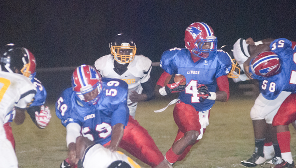Linden's Cordarius Scruggs finds a hole to run through against Ellwood Christian on Thursday night.