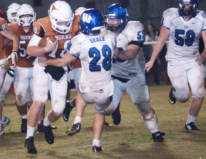 Hayden Huckabee runs through a Wilcox Academy tackler.
