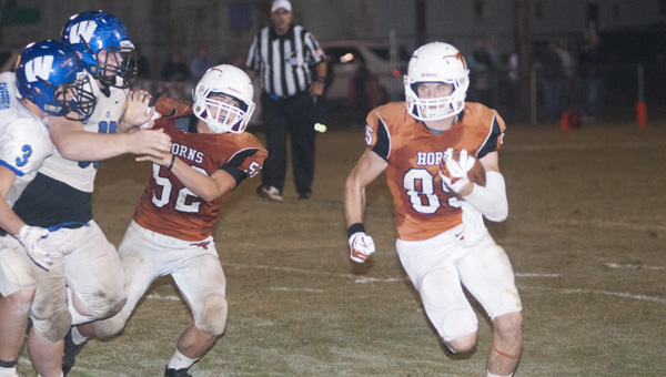 Shade Pritchett carries the ball around the left side for Marengo Academy in Thursday's game against Wilcox Academy. Pritchett ended the game with 149 yards rushing on four carries.
