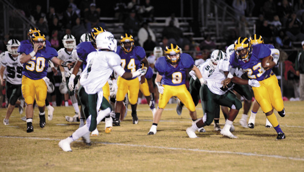 Sweet Water's Jaylin Johnson runs through a Flomaton tackler in Friday night's win over the Hurricanes.