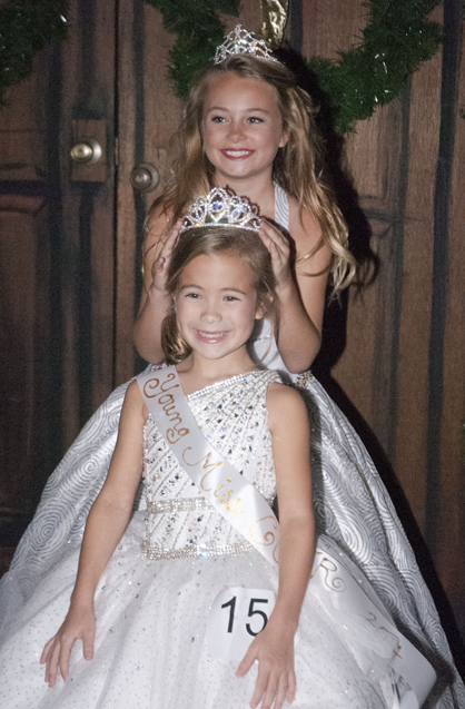 2014 Young Miss COTR Taylor Mills Quinney is crowned by 2013 Young Miss COTR Buckley Nettles.