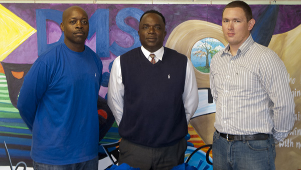 Demopolis Local 3663 Union President Greg Russell (left) and Demopolis firefighter and union member Justin King (right) donate sweatshirts to Demopolis Middle School. Russell and King are shown with DMS Assistant Principal Rollie McCall.
