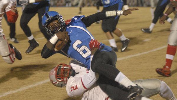 Demopolis' Jayjerein Craig falls forward through a tackle. Craig had a touchdown run in Friday's loss to B.C. Rain.