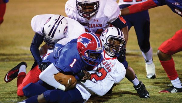 Linden High School quarterback Dewayne Charleston Jr. fights for yardage during the Patriots' 42-0 win over Chickasaw High School Friday night. (Times Staff/Andy Brown)