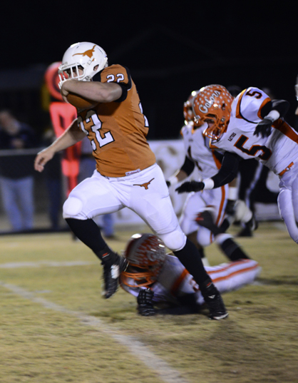 Josh Holifield breaks through for a touchdown run in the first quarter of Friday's game.
