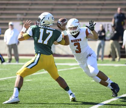 Cason Cook puts pressure on Edgewood Academy quarterback Ryan Bottoms.