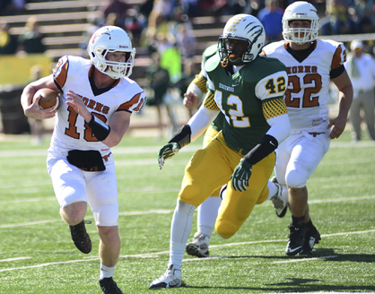 Hayden Huckabee tries to run past an Edgewood Academy defender in the Longhorns' loss Friday afternoon in the AISA Class AA championship game.