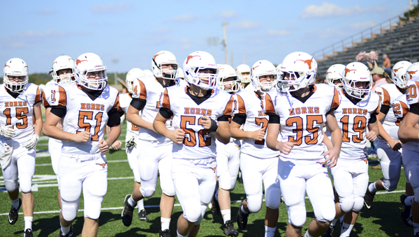 The Longhorns take the field before the AISA Class AA state championship.