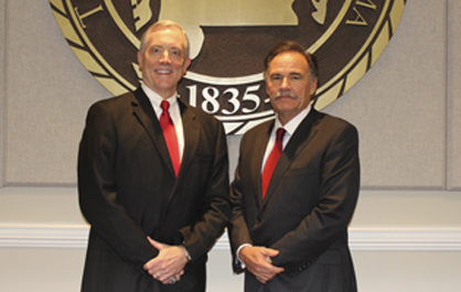Dr. Ken Tucker, left, has been elected by the University of West Alabama Board of Trustees to serve as president of the 179-year-old institution, effective Jan. 1, 2015. Pictured with Tucker is Board of Trustees President Terry Bunn.