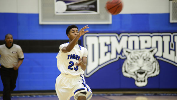 Anthony McIntosh passes ahead to a teammate in Thursday night's 64-60 overtime win over Thomasville.