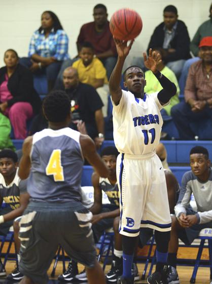 Demetrius Smith takes a jump shot for Demopolis.