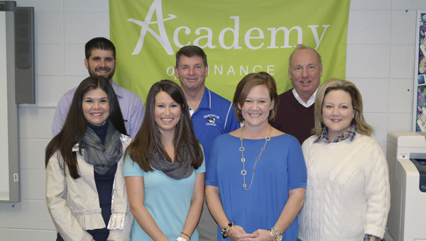 Demopolis High School is no enrolling freshman for the National Academy Foundation Academy of Finance and Insurance. Pictured are Adam Sealy, career technical education director; Dr. Tony Speegle, principal; William Barley, academic counselor; Kelly Gandy, academy director; Courtney Kerby, NAF instructor; Leslie May, academic counselor; and Connie Davis, NAF instructor.