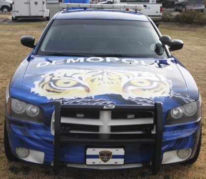 """The wrap promotes the school system with a tiger on the hood and """"Go Tigers"""" along the side of the car."""
