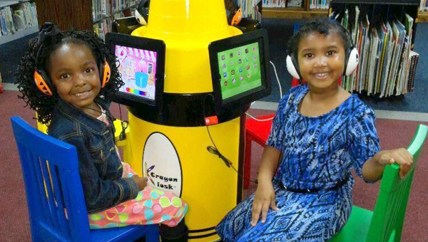 Mackenzie Banks and D'Miya Hawkins were the first children to use the new iPads at Demopolis Public Library.