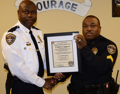 Reese presents a Chief's Citation to Sgt. Richard Bryant.
