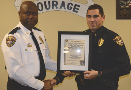 Reese presents a Chief's Citation to Officer Joshua Ochiltree.