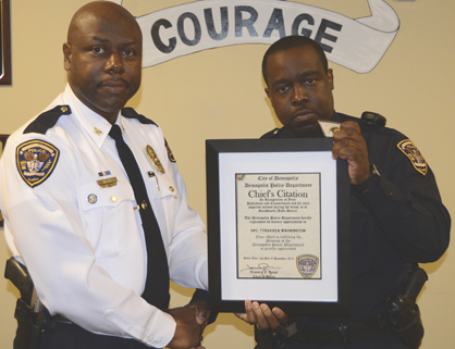 Reese presents a Chief's Citation to Officer Tyrrenza Washington.