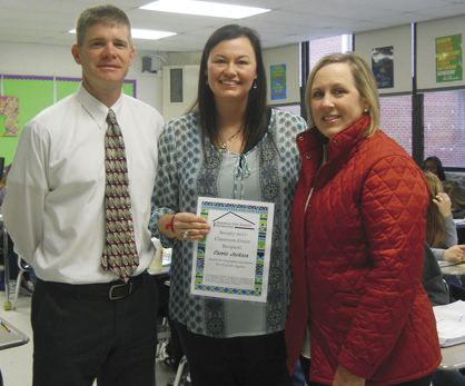 The Demopolis City Schools Foundation presented Demopolis Middle School teacher Carrie Jackson with a $3,000 grant to purchase 30 graphing calculators for the 8th grade algebra class. Pictured, left to right, are DMS principal Blaine Hathcock, Jackson, and DSCF president Sarah Chandler Hallmark.