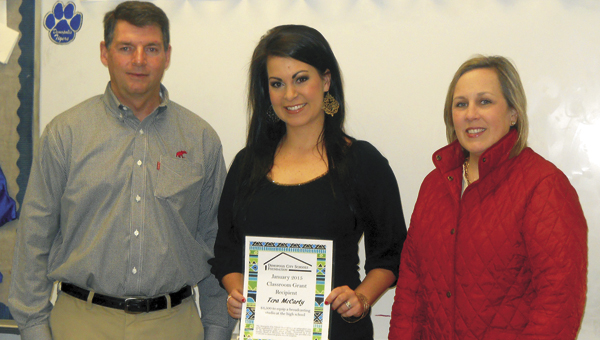 The Demopolis City Schools Foundation presented Demopolis High School teacher Tera McCarty with a $3,500 grant to equip the broadcasting studio at DHS. Pictured, left to right, are DHS principal Dr. Tony Speegle, McCarty, and DSCF president Sarah Chandler Hallmark.