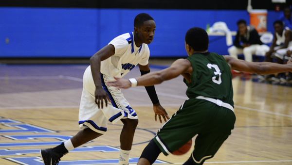 Demopolis' Demetrius Smith tries to get around a Dallas County defender in Tuesday night's loss to the Hornets.