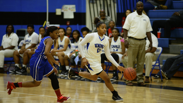 Demopolis' Ivery Moore brings the ball up the court for the Lady Tigers in their 47-40 loss to Wilcox Central on Tuesday.