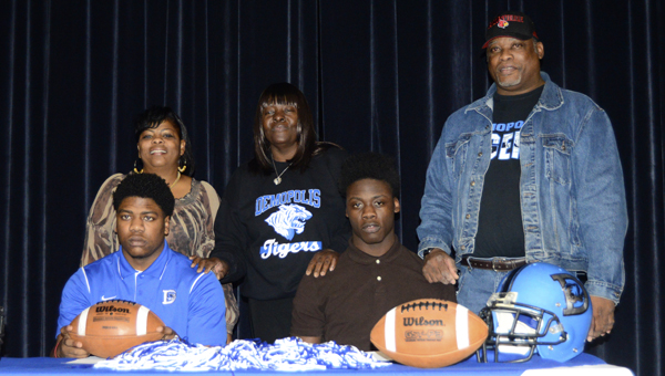 Demopolis signees Rashad Lynch (front left) and Tim Bonner (front right) are shown with their parents, from left to right, Jackie Lynch, Jessica Diane Bonner and Willie Bonner.