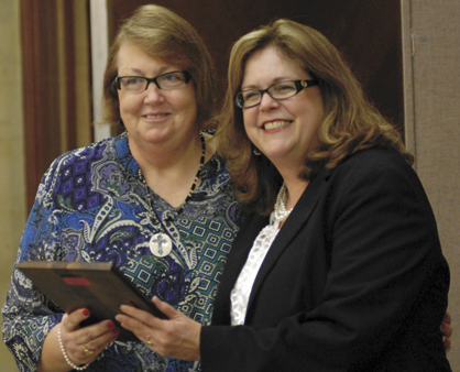 Paula Parr, left, is presented the Community Spirit Award by Barbara Myers.