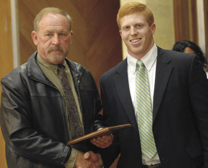 Mike Black, left, was presented the Chamber Volunteer of the Year award by Jacob Kerby.