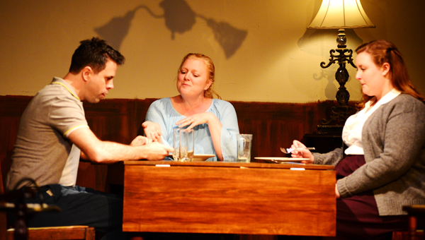 """Kirk Brooker, Karen Hill Dean and Katherine Oakes rehearse an early dinner scene from Tennessee Williams' """"The Glass Menagerie."""" The play will be performed Friday through Monday at the Old School on Main."""