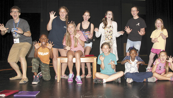 """Steven Martin, left, with cast members of this year's 21st Century Summer Theatre program. The cast is practicing this week for the opening of """"King Arthur's Quest"""" on Friday, 5 p.m., at the Demopolis High School Auditorium."""