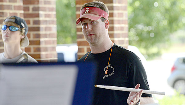 Demopolis High School Band Director Matt Fields and the marching band start knocking some of the dust off Monday at the high school as they began summer band camp.