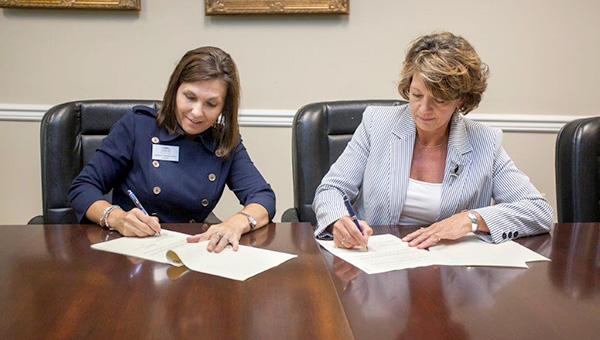 Dr. Andrea Mayfield, president of Shelton State Community College, and Diane Brooker, chairman of the Demopolis Industrial Development Board, sign the Letter of Intent for 6 acres of land in South Industrial Park to be used by the college for its truck driving school.