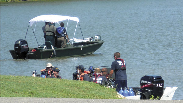 Members of the Tuscaloosa Fire and Water Rescue team leave from the Demopolis landing Sunday in search of a woman who went missing Saturday night on the Black Warrior River. The body was recovered Sunday afternoon.