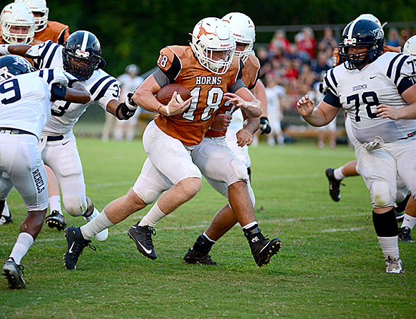 Hayden Huckabee makes his way through the Bessemer defense. The senior finished with over 100 rushing yards.