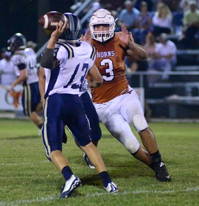Cason Cook closes in on the Russell Christian passer.