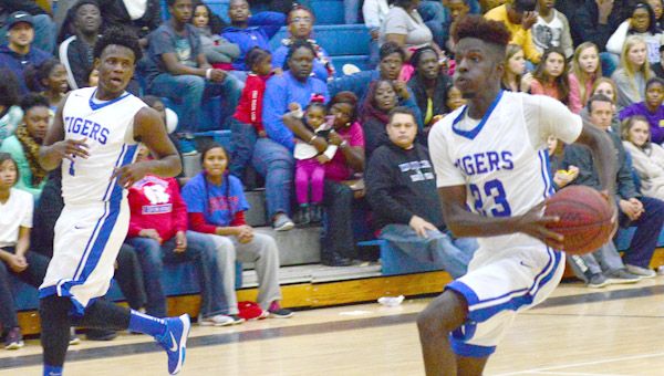 Antonie Collier drives the lane for a lay up.
