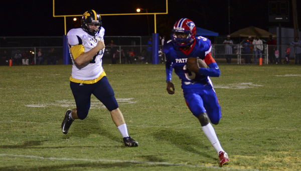 Quarterback Christopher Robinson scrambles against a Mckenzie defender. Robinson tossed three touchdown passes to help move Linden to the second round.