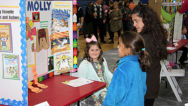 """Molly Stephens, a second grader at Westside Elementary, showcases her writing titled, """"I'm So Thankful."""""""