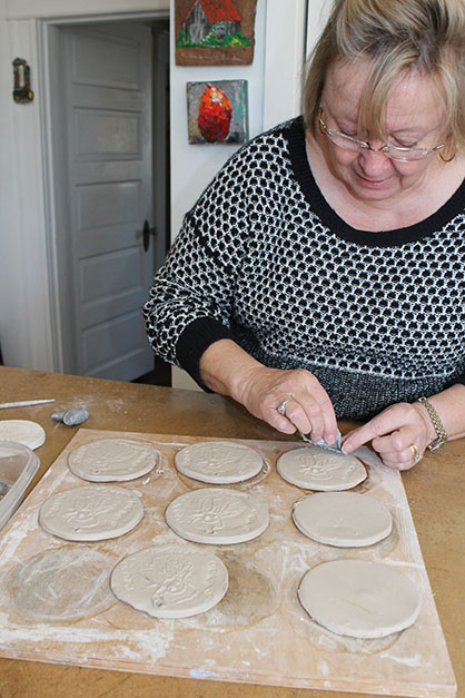 Carolyn Cowling, a potter, is creating special medals that will be presented to the winners of the Cock's Crow Run to be held on April 9 as a kickoff to Rooster Day.