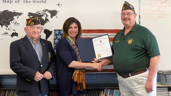 Meggin Mayben, a teacher at Demopolis Middle School, was selected Teacher of the Year by the Veterans of Foreign Wars District 6. District 6 serves an 11-county area. Mayben will now be among eight considered for the VFW's statewide Teacher of the Year Award. She is pictured with Post 5377 members Douglas Null, left, and Phillip Spence.