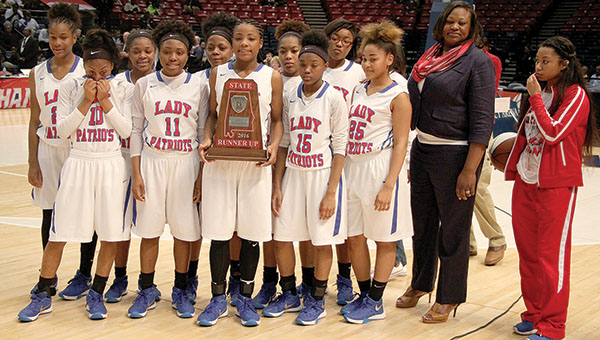 The Linden Lady Patriots with their State 1A Runner-up trophy following the championship game Thursday at the Birmingham-Jefferson Civic Center. The Lady Patriots fell to Spring Garden in the title game, 64-38.