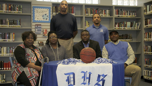 Josh Moore, who started playing varsity basketball in seventh grade at John Essex, will take his versatile skill set to Southern Union. Moore is pictured with Willa Johnson, grandmother; Pracey Moore, mother; SU coach Ron Radford; DHS coach Ashley Allen and Micheal Moore, Sr., father.