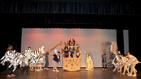"Catherine Akins, in the role of Rafiki, leads the ensemble in the opening song, ""The Circle of Life."""
