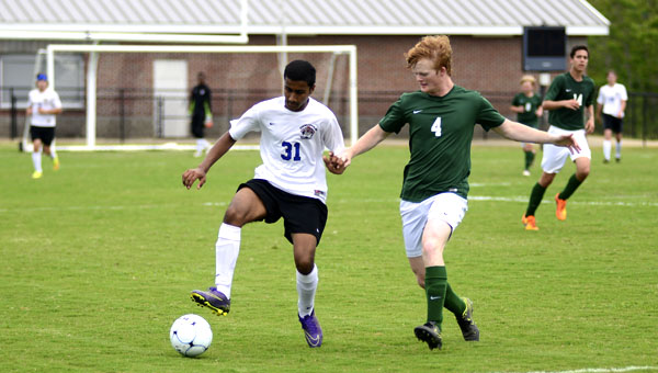 Smit Patel tries to setup the Demopolis attack against Holtville. DHS won 10-0 and Patel finished with a goal.