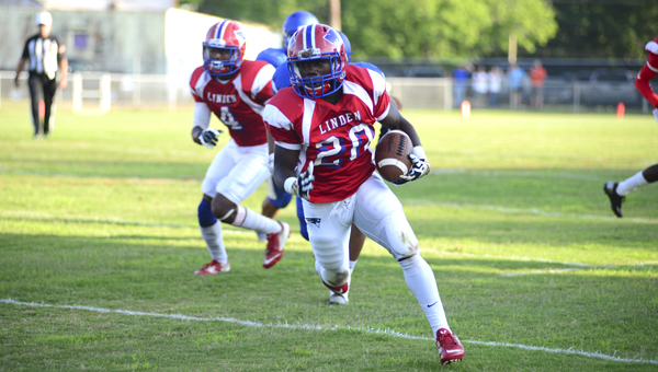 Justin Jenkins breaks free for a big gain against Winterboro during the Patriots' spring game at Linden Athletic Field.