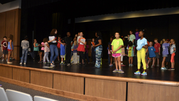 Participants in 'The Princess and the Frog' receive instructions during practice for the upcoming production.