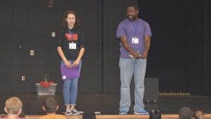 Directors Katie Gehrmann and Christopher Martin talk to the participants of the play before a break in rehearsal.