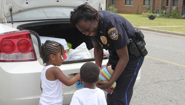 Demopolis Police Officer Serena Green is a big hit in local neighborhoods as she shares popsicles during her shifts.