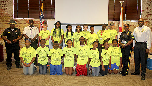 Sgt. Richard Bryant, School Resource Officer Tyrrenza Washington, Sgt. Monica Oliver and Chief Tommie Reese pictured with the participants of this summer's second session of the 2016 Demopolis Police Youth Leadership Academy.