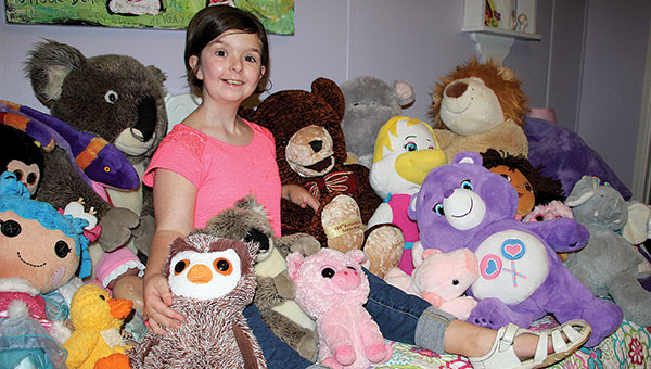 Anna-Coleman Yelverton was diagnosed with Rhabdomyosarcoma at the age of 1. She is now 14 and has been in remission for about five years. One of her greatest joys in life is her collection of stuffed animals.